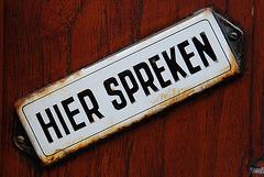 Enamel signs: Speak here