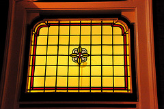 Stained-glass window above a door in Leiden