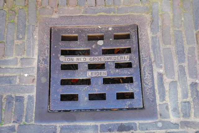 Sewer cover of the Koninklijke Nederlandse Grofsmederij