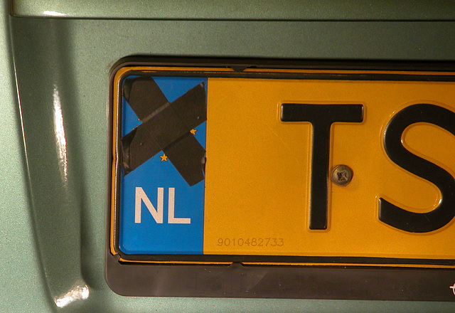 Somebody expressing his anti-European feeling by taping the EU symbol on his license plate