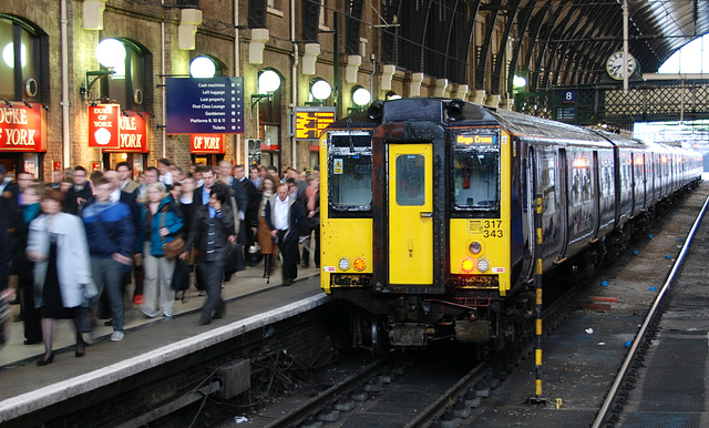 Commuters arriving at London King's Cross