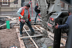Pouring new concrete in front of the Mauritshuis in The Hague