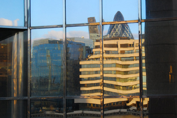 City reflected in Number One, London Bridge