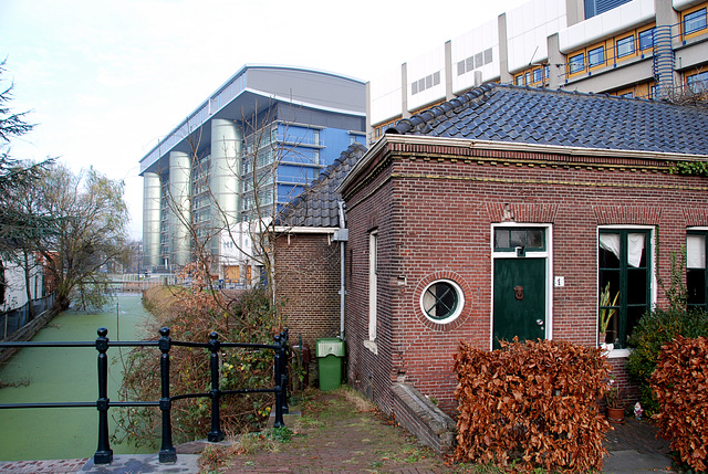 The Leiden University Medical Centre looming large over a old little building