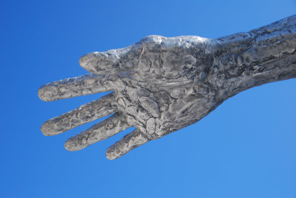 Reaching out across a blue sky