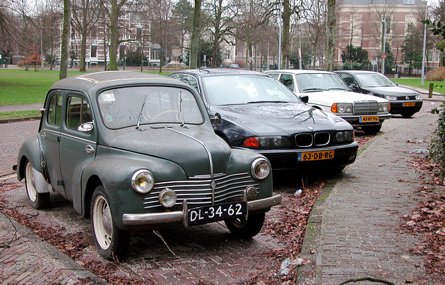 Brave little French car parked next to a German onslaught