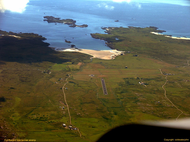 Aerial: View of Rwy 20 Island of Coll's new tarmac runway!