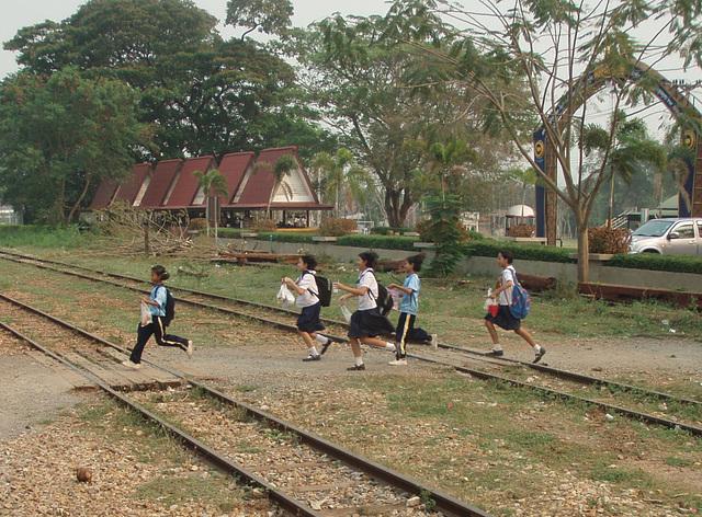 schoolchildren running to catch the train