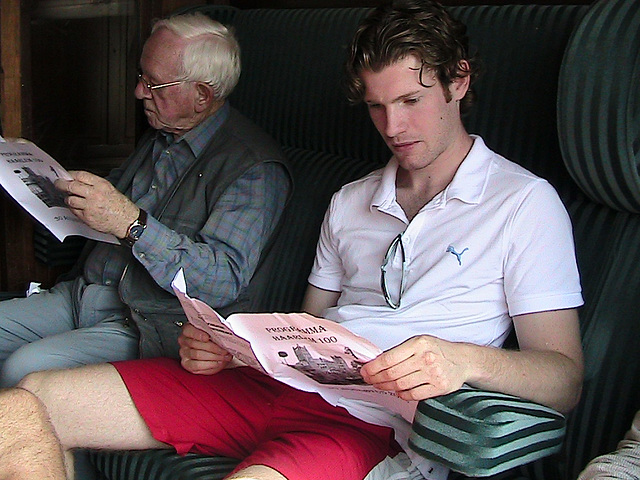 Celebration of the centenary of Haarlem Railway Station: Young and old reading the programme of the day in a first-class carriage