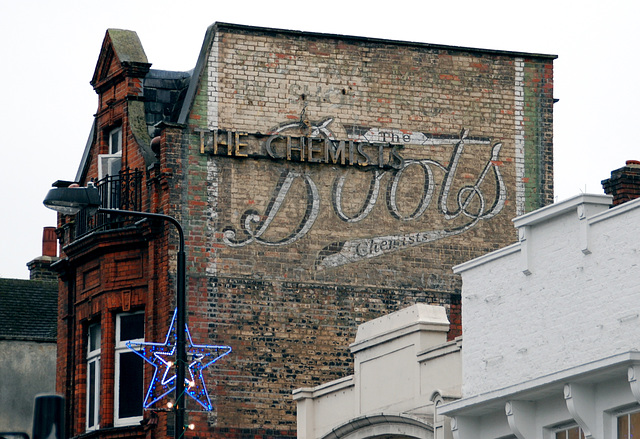 A visit to Camden Town: Old Boots advertisement