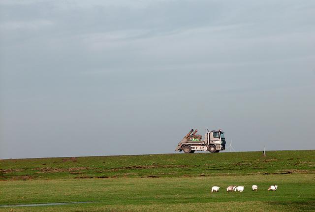 Truck speeding along the dike