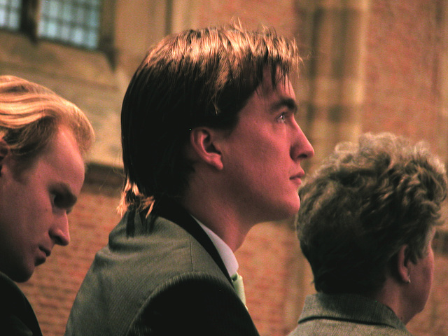 A young man listening to the speeches