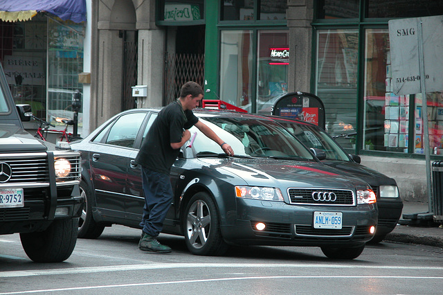 Washing car windows at the traffic light for a living