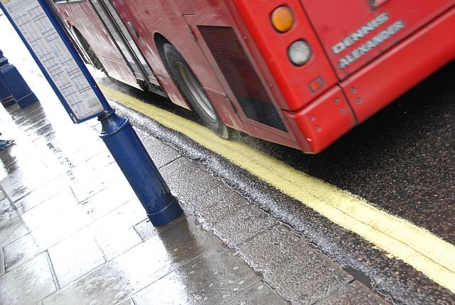 Asphalt curling over the pavement on Regent Street