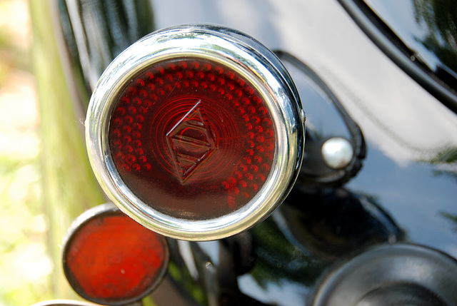 Oldtimer day at Ruinerwold: rear light of a 1936 Renault Primaquatre Sport