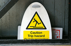 Sign waiting for another trip hazard to occur