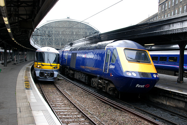 Heathrow Express next to a intercity