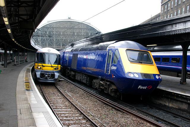 Heathrow Express next to a intercity