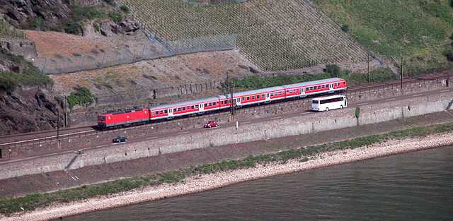 German train riding along the Rhine