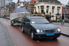 2000 Mercedes-Benz E 220 CDI Combi Taxi with a boat on tow