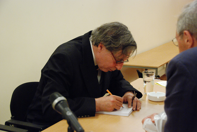 The writer J.M.A. Biesheuvel signing a Russian translation of his work