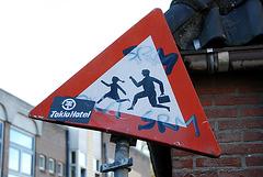 Old traffic sign warning against running children
