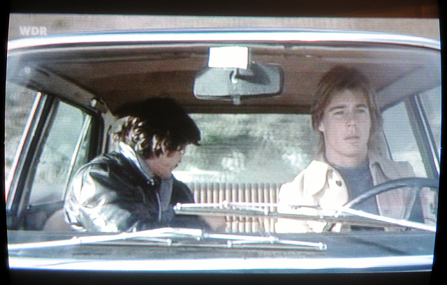 Charles Bronson and Jan-Michael Vincent driving in a Fiat