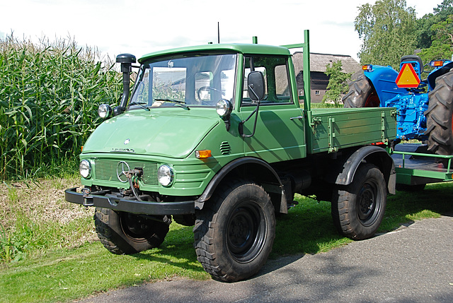 Unimog pulling a tractor
