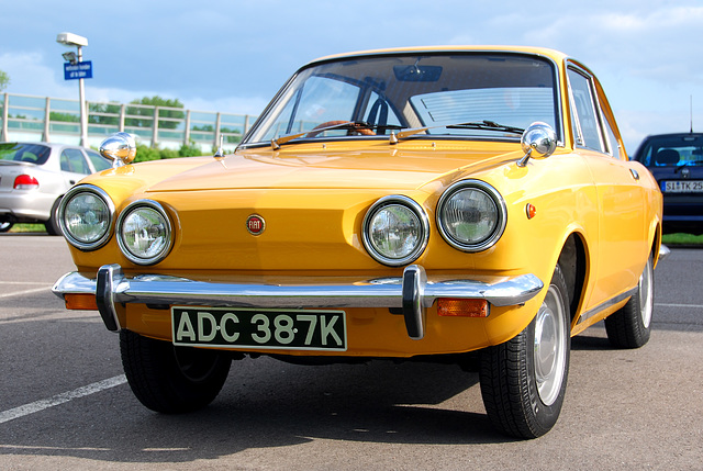 Little yellow Fiat 850 visiting Holland from England