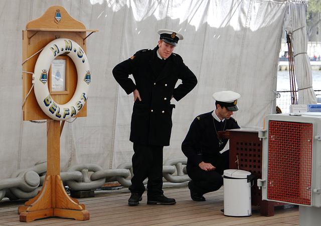 Men in uniform aboard HMS Belfast