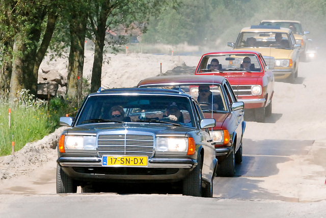 Mercedes-Benzes and an Opel
