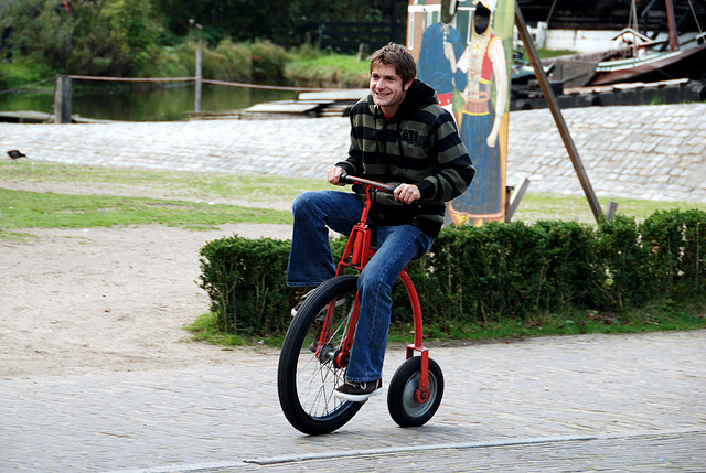 A visit to the Open Air Museum (Heritage Park): somebody succeeding to ride the velocipede