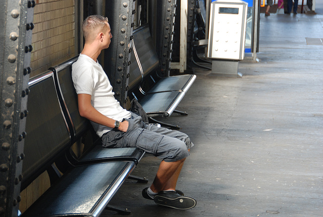 Celebration of the centenary of Haarlem Railway Station: sitting on a bench