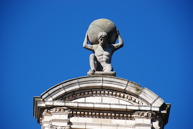 Things on rooftops: a statue of Atlas