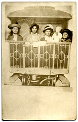 Four Women and a Doll on a Train