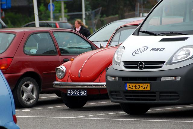 1971 Volkswagen Beetle hiding behind an Opel