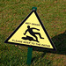 Dangerous wet grass in the form of an oil slick