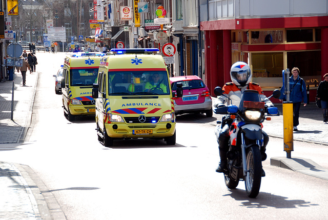 Two ambulances escorted by the police