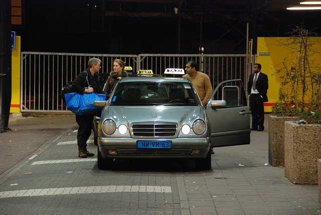 Negotiating a taxi in front of The Hague Central Station