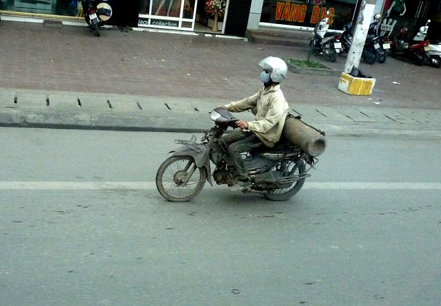 Old Motorbike Carrying a Big Gas Cylinder