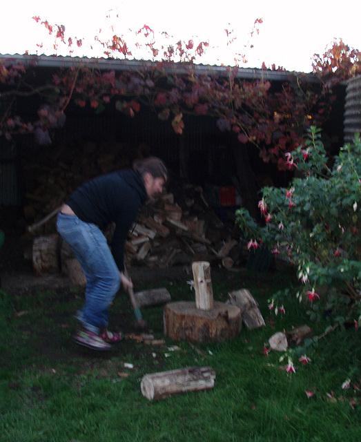 WWOOFer Emilie splitting wood
