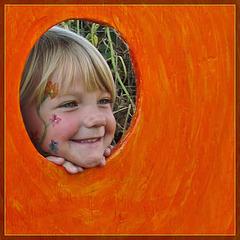 Little Girl in Pumpkin Face