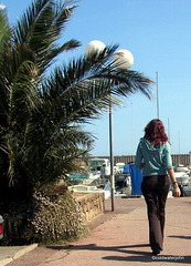 St Tropez Summer Girl strolling by the harbour