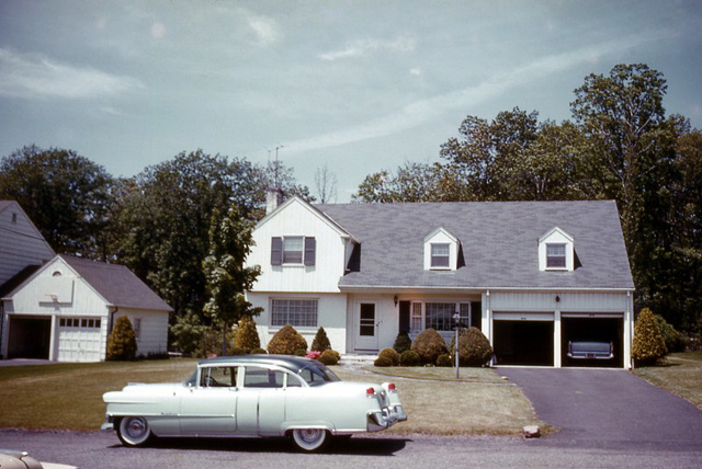 Car in Front of a Two-Garage House