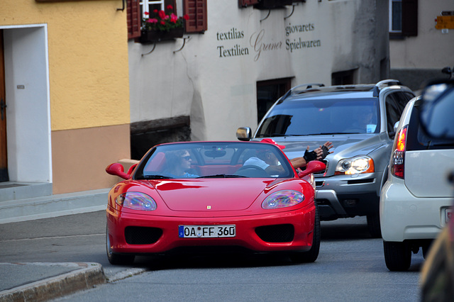 Holiday 2009 – Ferrari driver explains to a dim-witted driver how many cars fit in a narrow street