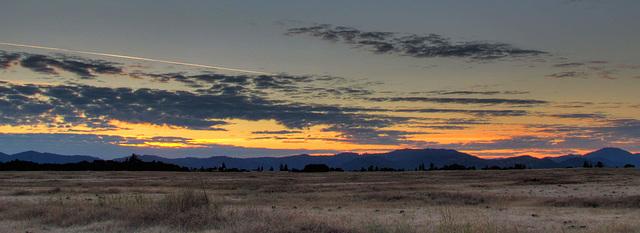 Sunset Panorama with Jet Stream