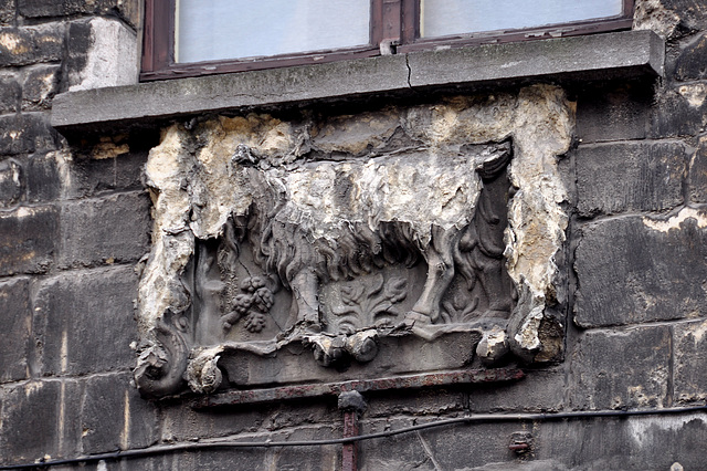 Damaged gable stone in Antwerp