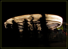 Carousel with People Walking Past