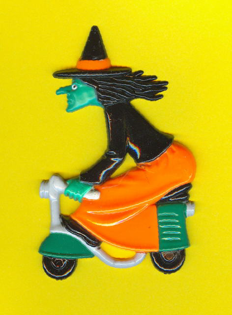 Witch on a moped