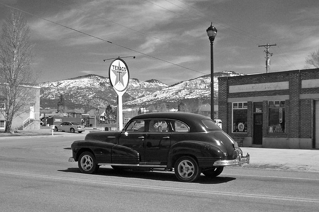 Texaco and vintage car in b/w